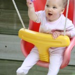 Yee haa in the swing Alice 8 months