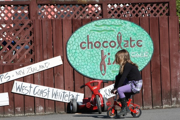 Charlotte riding a mini bike at Chocolate Fish