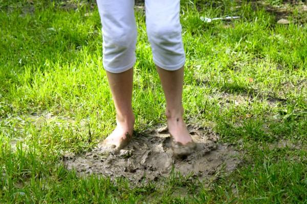 Charlotte delighting in mud