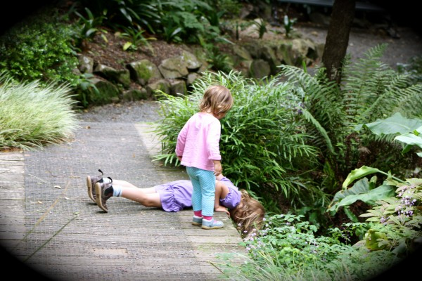 Sophie & Alice watching leaves float down stream