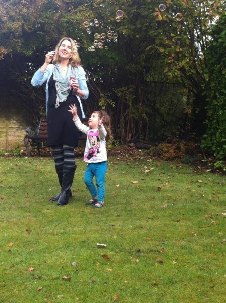 Bubble blowing with young Alice in Grandma & Granddad's garden
