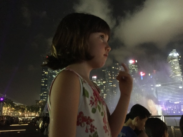 Alice watching the laser light show at Marina Bay Waterfront Promenade