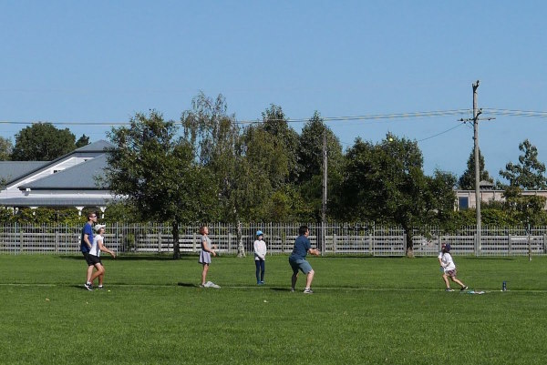 Tennis cricket with the children on the school field in Martinborough.