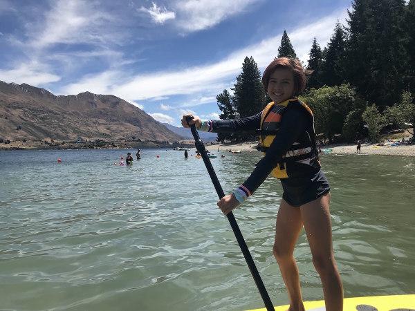 Sophie paddle boarding on Lake Wanaka